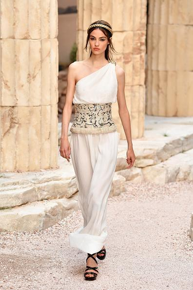 <p>A model in a Grecian-inspired white dress walks the runway during Chanel Cruise 2018 Collection at Grand Palais in Paris. (Photo: Getty Images) </p>