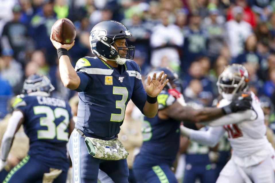 Russell Wilson added another notch to his MVP campaign with a massive day against the Bucs. (Joe Nicholson/Reuters)