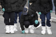 Police officers work at the scene of Sunday's terror stabbing attack in the Streatham area of south London Monday Feb. 3, 2020. Police in London say the man identified as 20-year-old Sudesh Amman was wearing a fake bomb and stabbed two people Sunday before being shot to death by police was recently released from prison, where he was serving for terrorism offenses. (AP Photo/Alberto Pezzali)
