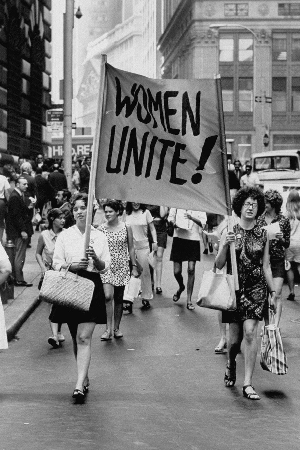 <p>Women band together to rally for the Women's Liberation demonstration on Fifth Avenue and Wall Street. </p>