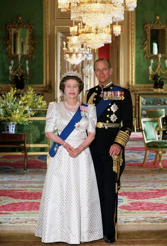 <p>In this portrait taken to celebrate her 40th wedding anniversary to Prince Philip, Queen Elizabeth chose a white dress with a dot pattern. She accessorized with a sparkling tiara and elaborate diamond necklace as well. </p>