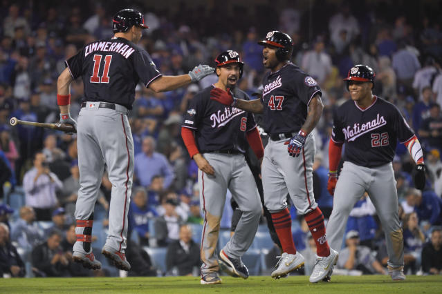 Washington Nationals' Howie Kendrick (47) celebrates after a grand slam against the Los Angeles Dodgers during the 10th inning in Game 5 of a baseball National League Division Series on Wednesday, Oct. 9, 2019, in Los Angeles. (AP Photo/Mark J. Terrill)