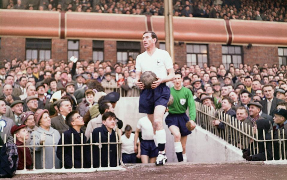 Tottenham Hotspur Double Winning Season. FA Cup Semi Final v Burnley. Danny Blanchflower leads the team out followed by goalkeeper Bill Brown. - Daily Herald/Mirrorpix/Mirrorpix via Getty Images