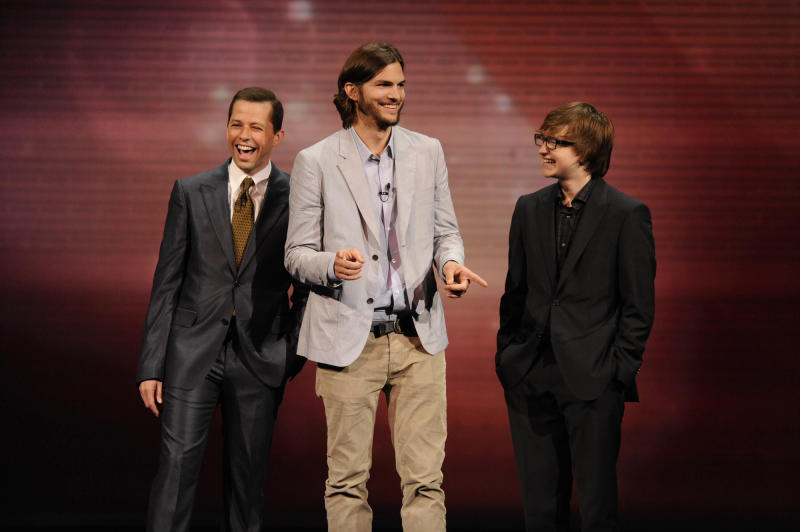 "In this May 18, 2011 publicity image released by CBS, the cast of ""Two and a Half Men,"" from left, Jon Cryer, Ashton Kutcher, and Angus T. Jones are shown during their presentation at CBS' Upfront, at Carnegie Hall, in New York. CBS said Friday, April 26, 2013, it's renewed ""Two and a Half Men"" for another season. (AP Photo/CBS,  Jeffrey R. Staab, File)"