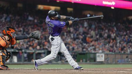 May 18, 2018; San Francisco, CA, USA; Colorado Rockies first baseman Ian Desmond (20) hits a ground rule double RBI during the sixth inning against the San Francisco Giants at AT&T Park. Mandatory Credit: Neville E. Guard-USA TODAY Sports