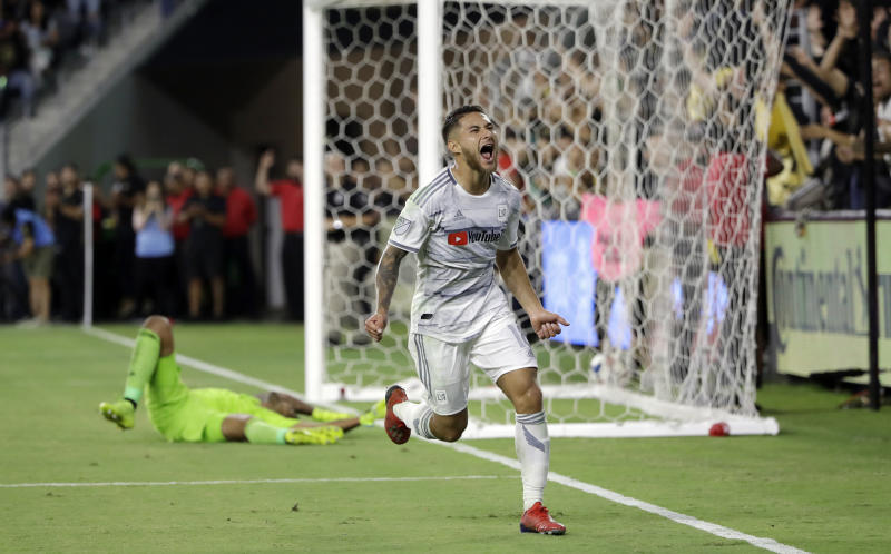 Los Angeles FC's Joshua Perez, front, celebrates his goal against San Jose Earthquakes goalkeeper Daniel Vega during the second half of an MLS soccer match Wednesday, Aug. 21, 2019, in Los Angeles. (AP Photo/Marcio Jose Sanchez)