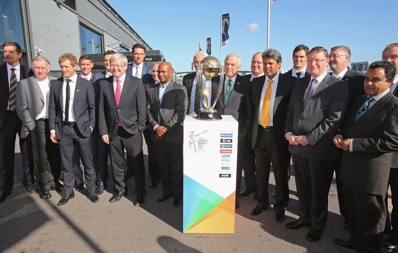 MELBOURNE, AUSTRALIA - JULY 30:  Former Australian cricketers Dennis Lillee, Ian Chappell, Adam Gilchrist, Mike Hussey, George Bailey, Australian Prime Minister Kevin Rudd, Ralph Waters, Chairman, ICC Cricket World Cup 2015; Kapil Dev; Sanath Jayasuriya and Premier of Victoria, Denis Napthine pose with the ICC Cricket World Cup trophy during the Official Launch of the ICC Cricket World Cup 2015 on July 30, 2013 in Melbourne, Australia.  (Photo by Scott Barbour/Getty Images)