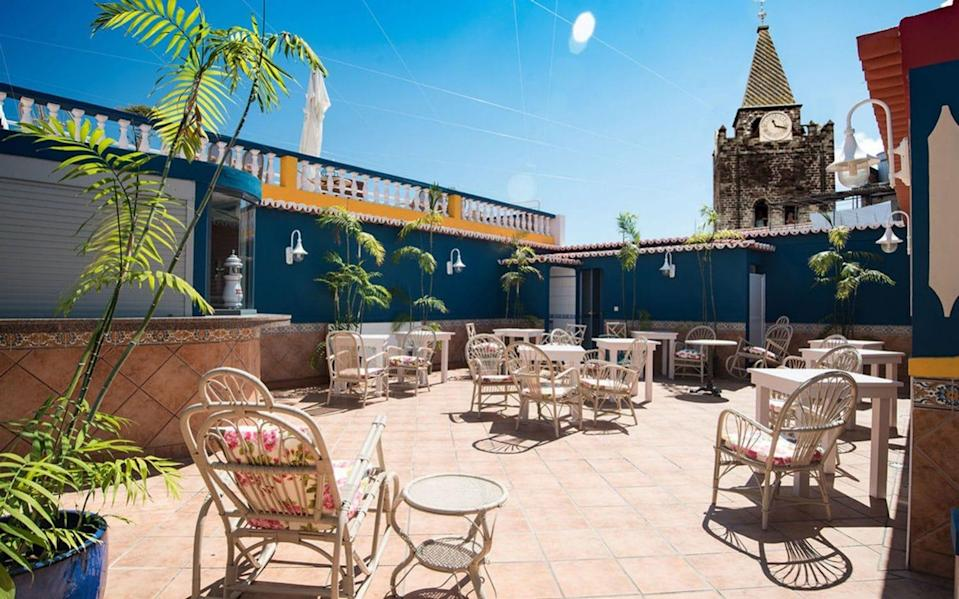 colourful rooftop bar with spire of cathedral in view