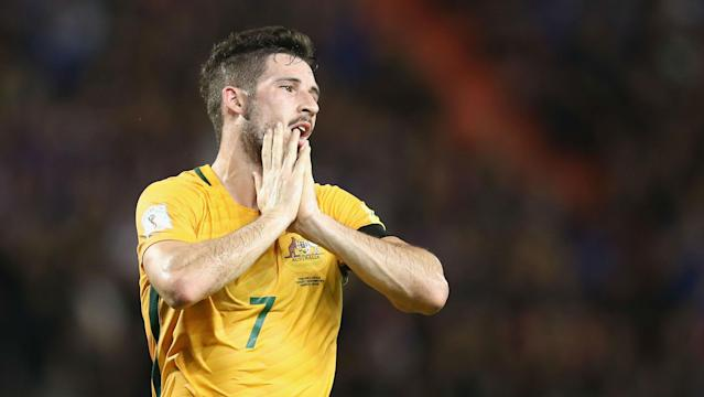Mathew Leckie's first-half goal was not enough to secure Australia a much-needed victory as Iraq earned a share of the spoils in Tehran.