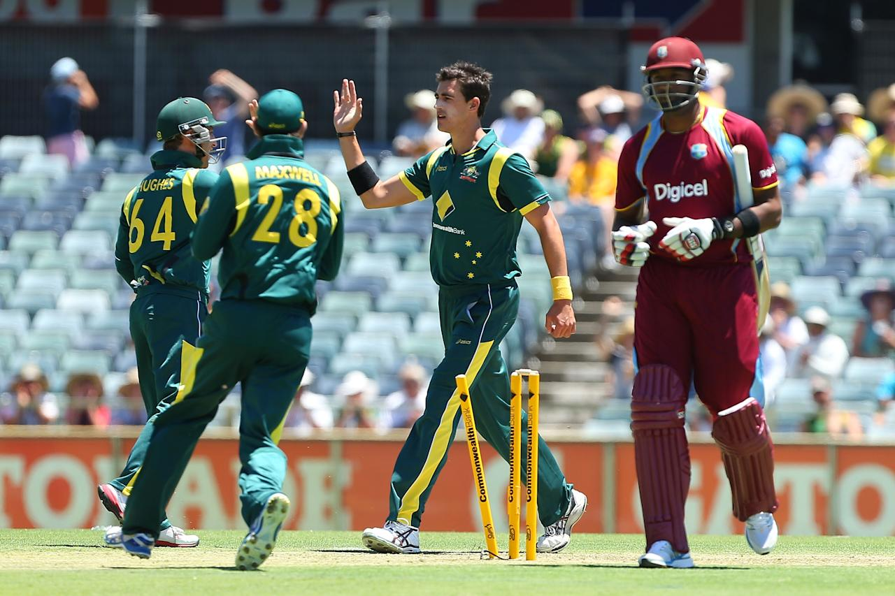 PERTH, AUSTRALIA - FEBRUARY 01:  Mitchell Starc of Australia celebrates the wicket of Kieron Pollard of the West Indies during game one of the Commonwealth Bank One Day International Series between Australia and the West Indies at WACA on February 1, 2013 in Perth, Australia.  (Photo by Paul Kane/Getty Images)