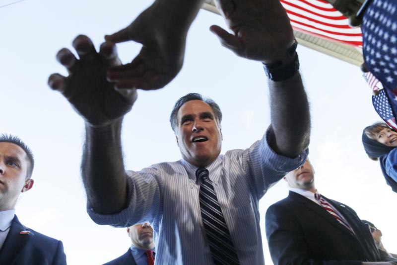 Republican presidential candidate and former Massachusetts Gov. Mitt Romney reaches out to shake hands with supporters as he campaigns at Colorado Springs Municipal Airport in Colorado Springs, Col., Saturday, Nov. 3, 2012. (AP Photo/Charles Dharapak)