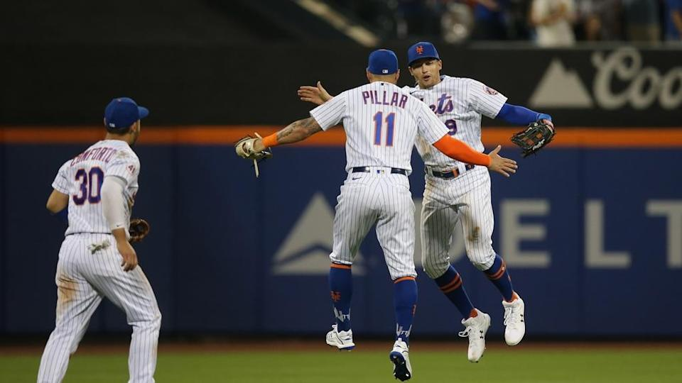 Kevin Pillar and Brandon Nimmo jump in celebration of win over Brewers