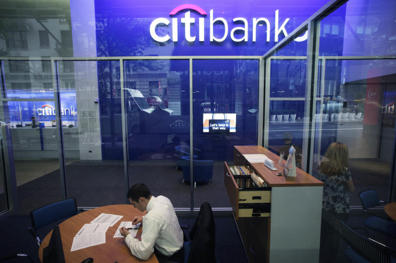 FILE - This Oct. 13, 2011 file photo, shows a Citibank branch in New York.  Citigroup said Wednesday, Dec. 5, 2012, that it will cut 11,000 jobs, a bold early move by new CEO Michael Corbat. The cuts amount to about 4 percent of Citi's workforce of 262,000.  The bulk of the cuts, about 6,200, will come from Citi's consumer banking unit, which handles everyday functions like branches and checking accounts.  (AP Photo/Mark Lennihan, File)