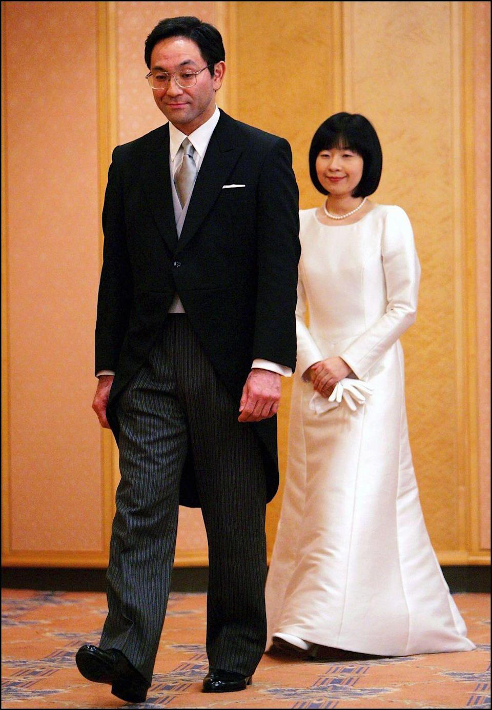 <p>Technically, this one is not a royal wedding as Princess Nori of Japan <em>left behind</em> the world's oldest hereditary monarchy to marry commoner Yoshiki Kuroda, a government official she met as a child. The only daughter of Emperor Akihito, the princess is now Mrs. Sayako Kuroda and lives in a rented Tokyo apartment. For her wedding day, she wore a brilliantly minimalist, A-line dress with satin gloves and a pearl necklace. </p>
