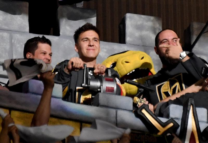"Professional sports gambler and ""Jeopardy!"" champion James Holzhauer of Nevada (C) has become so popular, he was invited to sound a siren in the Castle at a Vegas Golden Knights NHL playoff game on April 21, 2019 (AFP Photo/Ethan Miller)"