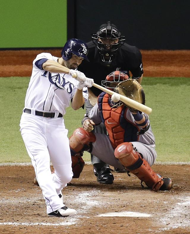 Tampa Bay Rays' David DeJesus hits a single to drive in a run in front of Boston Red Sox catcher Jarrod Saltalamacchia in the sixth inning of Game 4 of baseball's American League division series, Tuesday, Oct. 8, 2013, in St. Petersburg, Fla. (AP Photo/John Raoux)