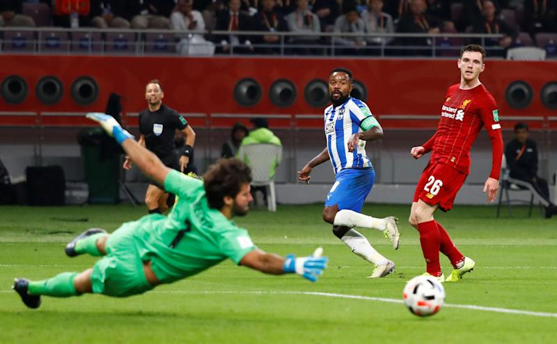 Soccer Football - Club World Cup - Semi Final - Monterrey v Liverpool - Khalifa International Stadium, Doha, Qatar - December 18, 2019 Monterrey's Dorlan Pabon has a shot saved by Liverpool's Alisson REUTERS/Corinna Kern