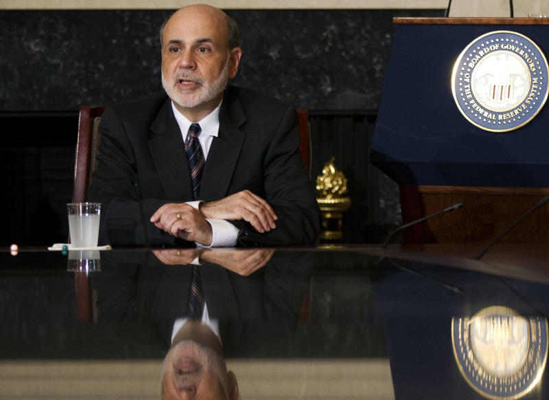 FILE- In this Tuesday, Aug. 7, 2012, file photo, Federal Reserve Chairman Ben Bernanke speaks to educators in the board room of the Federal Reserve in Washington, during a town hall meeting.  Investors are hoping Chairman Ben Bernanke will at least hint Friday, Aug. 31, 2012,  that the Federal Reserve is ready to launch another round of bond purchases to try to lower long-term U.S. interest rates and spur more borrowing and spending. (AP Photo/Manuel Balce Ceneta, File)