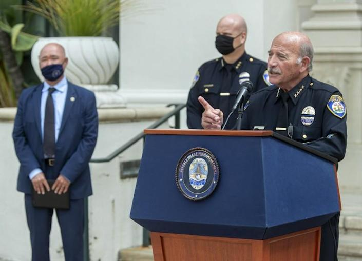 BEVERLY HILLS, CA - MAY 12, 2021: Dominick Rivetti, right, Interim Beverly Hills Police Chief, takes a reporter's question while discussing the arrest of 3 gang members in the armed robbery at a popular Beverly Hills restaurant on March 4, 2021, where a $500,000 watch was stolen. In background left is Matthew Moon, Special Agent in charge of the criminal division, FBI, Los Angeles and in background, center is Marc Coopwood, Beverly Hills Assistant Chief of Police. Press conference was held outside of Beverly Hills City Hall. (Mel Melcon / Los Angeles Times)