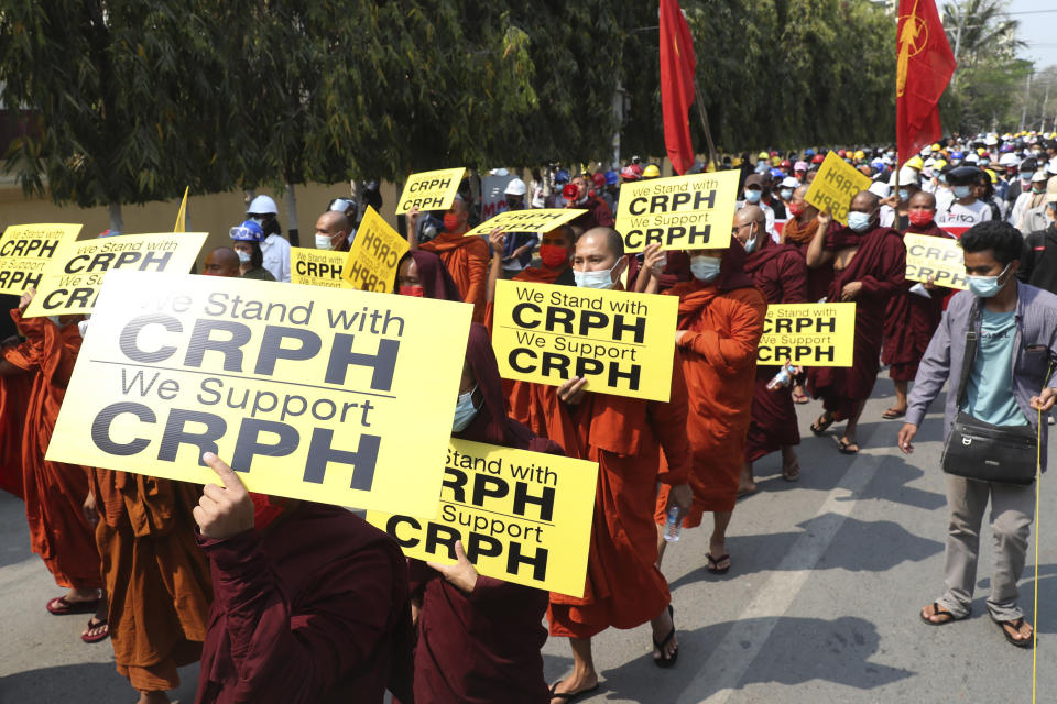 Monks hold signs as they march during an anti-coup protest in Mandalay, Myanmar, Saturday, March 6, 2021. The U.N. special envoy for Myanmar on Friday called for urgent Security Council action, saying about 50 peaceful protesters were killed and scores were injured in the military's worst crackdowns this week. (AP Photo)