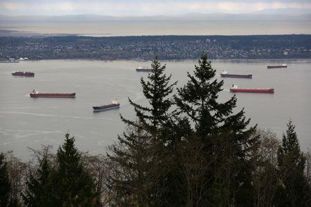 Cargo ship lie at anchor in English Bay outside the Port of Vancouver