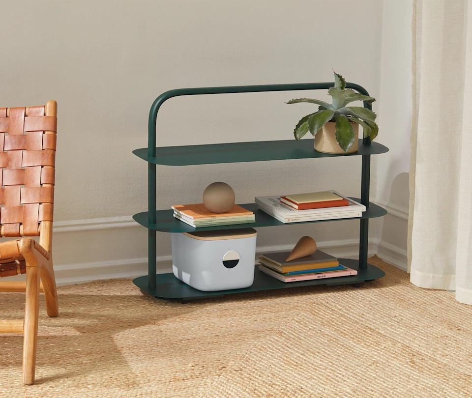 <p>The green shade of this <span>Open Spaces Entryway Rack</span> ($138) is actually so chic.</p>