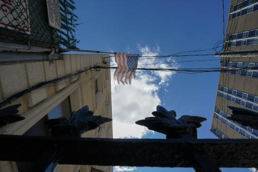 A tattered American flag hangs across the street from Wyckoff Hospital in Brooklyn, New York
