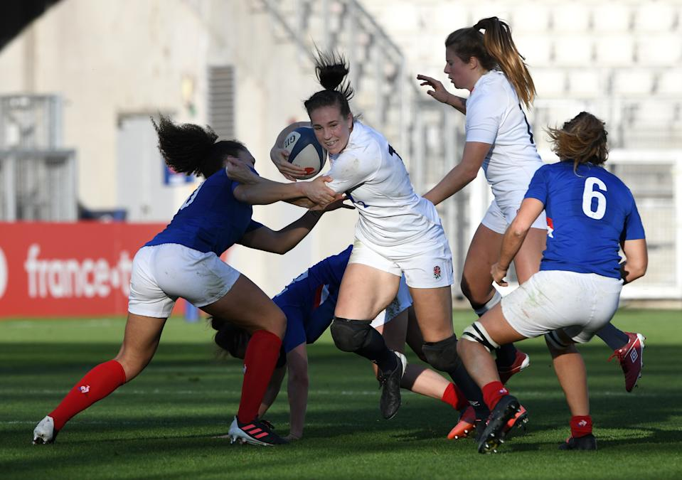 GRENOBLE, FRANCE - NOVEMBER 14: Emily Scarratt of England breaks through contact  during the France Women v England Women Autumn International series match at Stade des Alpes on November 14, 2020 in Grenoble, France. Sporting stadiums around France remain under strict restrictions due to the Coronavirus Pandemic as Government social distancing laws prohibit fans inside venues resulting in games being played behind closed doors.  (Photo by Chris Ricco - RFU/The RFU Collection via Getty Images)