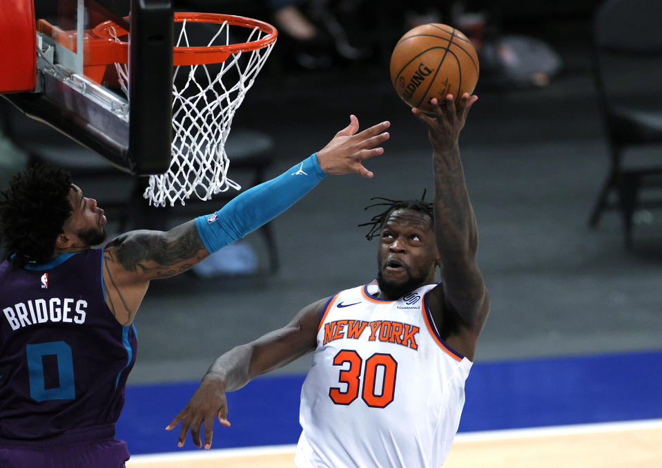 Julius Randle #30 of the New York Knicks goes to the basket as Miles Bridges #0 of the Charlotte Hornets defends during the second half at Madison Square Garden. Mandatory Credit:  Sarah Stier/POOL PHOTOS-USA TODAY Sports