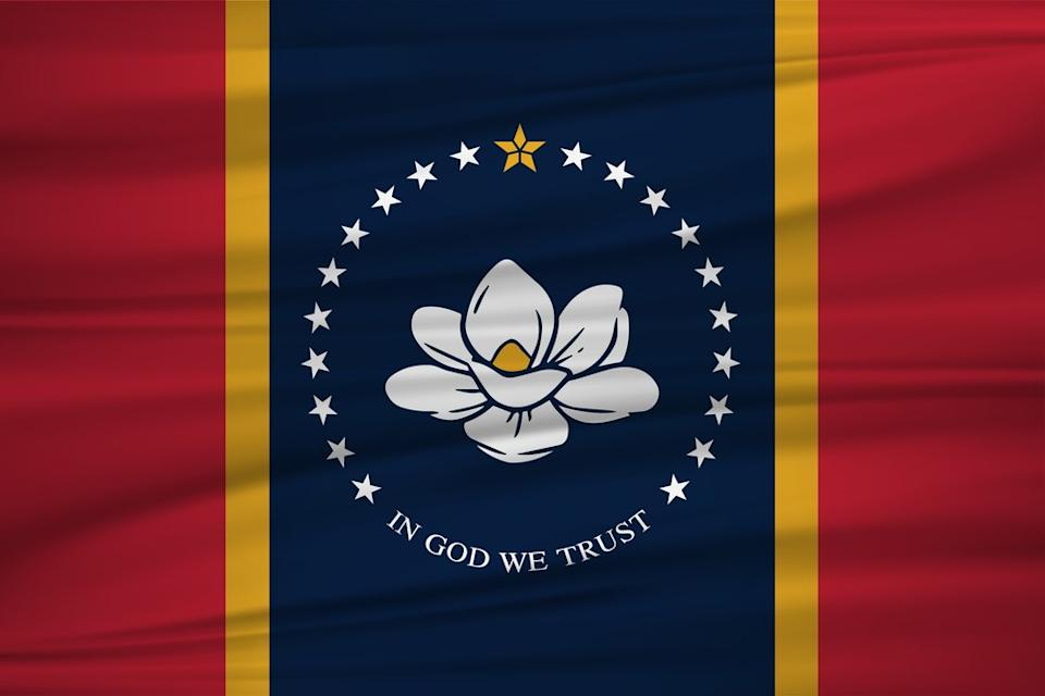 The new state flag of Mississippi with red, gold, and blue bars and a magnolia flower