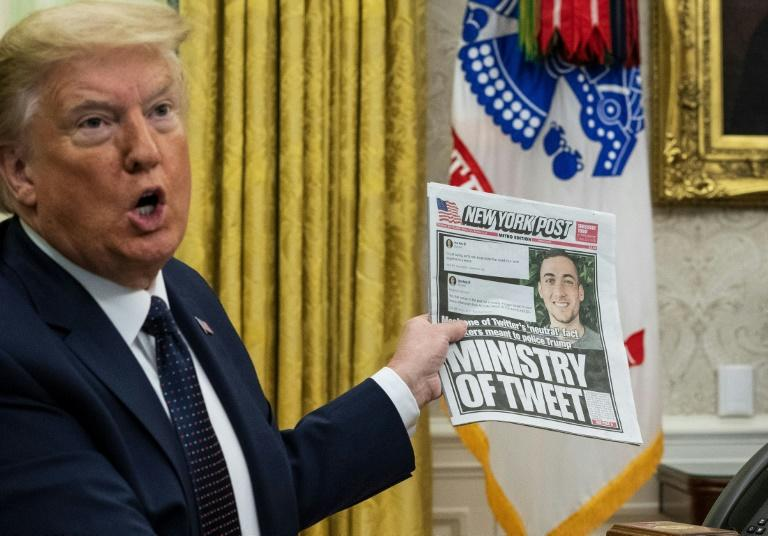 """President Donald Trump has accused social media of """"censorship"""" and limiting """"free speech"""" but his critics say he himself is seeking to regulate online content with his executive order (AFP Photo/Doug MILLS)"""