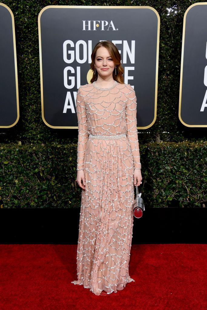 <p><i>The Favourite</i>'s Emma Stone wore a beaded Louis Vuitton Atelier dress that took more than 800 — yep, 800 — hours of work to create. She was nominated for her work in the Best Supporting Actress in a Movie category. (Photo: Getty Images) </p>