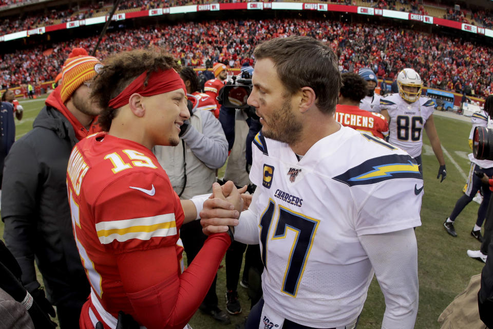 Kansas City Chiefs quarterback Patrick Mahomes (15) and Los Angeles Chargers quarterback Philip Rivers (17) talk after an NFL football game Sunday, Dec. 29, 2019, in Kansas City, Mo. (AP Photo/Charlie Riedel)