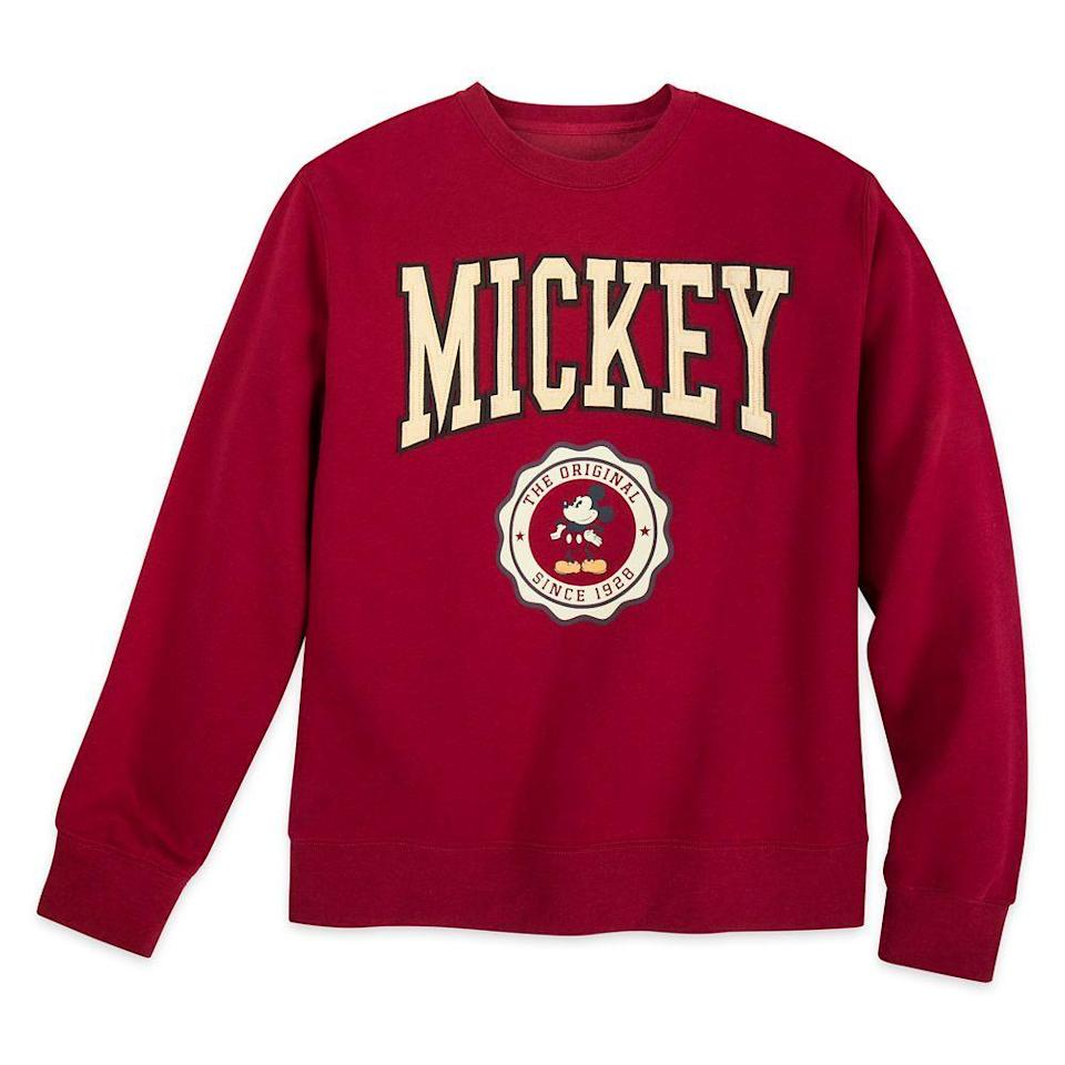 """<p>shopdisney.com</p><p><strong>$42.99</strong></p><p><a href=""""https://go.redirectingat.com?id=74968X1596630&url=https%3A%2F%2Fwww.shopdisney.com%2Fmickey-mouse-varsity-sweatshirt-for-adults-2025105780592M.html&sref=https%3A%2F%2Fwww.countryliving.com%2Fshopping%2Fgifts%2Fg34122456%2Fgifts-for-disney-lovers%2F"""" rel=""""nofollow noopener"""" target=""""_blank"""" data-ylk=""""slk:Shop Now"""" class=""""link rapid-noclick-resp"""">Shop Now</a></p><p>With collegiate-style lettering, this comfy fleece sweatshirt will have your sweetie dreaming of being the Big (Wo)man on Campus at Mickey U.</p>"""