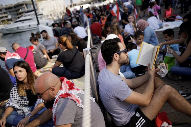 Protesters take part in the ongoinganti-governmentprotests in Beirut
