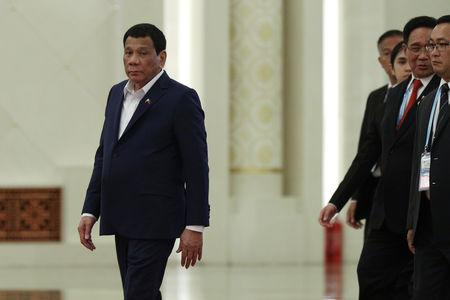 FILE PHOTO:  Philippine President Rodrigo Duterte arrives for the meeting with Chinese President Xi Jinping at the Great Hall of People in Beijing