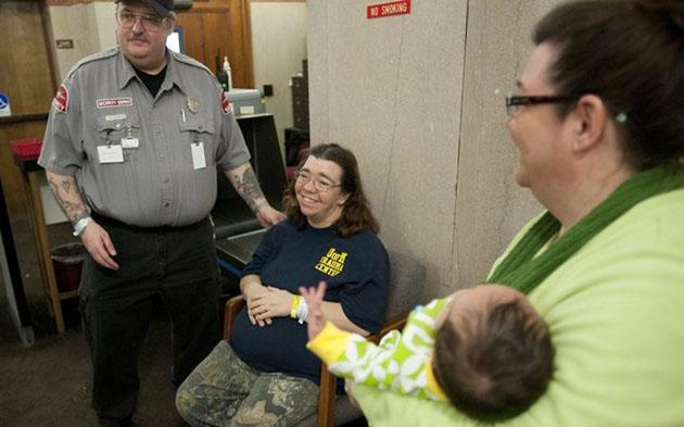 Mike and Linda Ackley (sitting) after the birth of Kimberley (J. Scott Park | Mlive.com)
