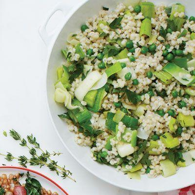 """<p>Hearty, chewy barley adds texture, taste, and nutrition to this healthy side dish.</p><p>Get the <a href=""""https://www.delish.com/uk/cooking/recipes/a34584614/barley-sauteed-leeks-peas-parsley-recipe-wdy0213/"""" rel=""""nofollow noopener"""" target=""""_blank"""" data-ylk=""""slk:Barley with Sautéed Leeks, Peas, and Parsley"""" class=""""link rapid-noclick-resp"""">Barley with Sautéed Leeks, Peas, and Parsley</a> recipe.</p>"""