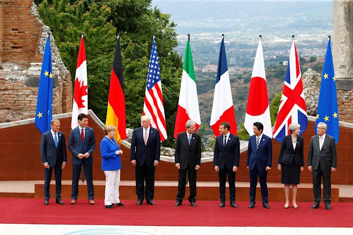 <p>From L-R, European Council President Donald Tusk, Canadian Prime Minister Justin Trudeau, German Chancellor Angela Merkel, U.S. President Donald Trump, Italian Prime Minister Paolo Gentiloni, French President Emmanuel Macron, Japanese Prime Minister Shinzo Abe, Britainís Prime Minister Theresa May and European Commission President Jean-Claude Juncker pose for a family photo during the G7 Summit in Taormina, Sicily, Italy, May 26, 2017. (Photo: Tony Gentile/Reuters) </p>