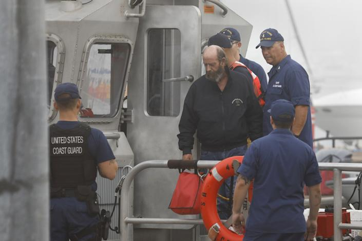 Dive boat captain Jerry Boylan is brought back to the U.S.Coast Guard station in Oxnard in Oct. 2019.