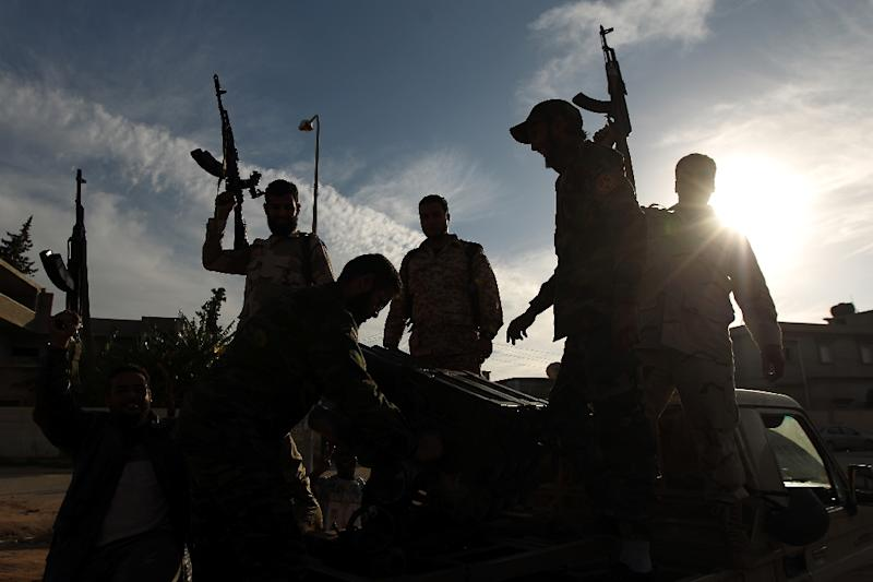 Members of a brigade loyal to General Khalifa Haftar hold up their guns in the eastern Libyan city of Benghazi on December 17, 2014 (AFP Photo/Abdullah Doma)