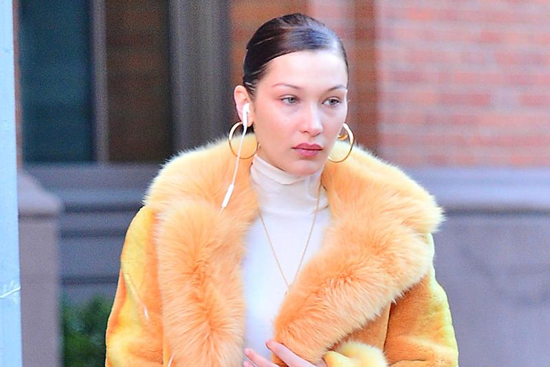 2d23569131d96 Bella Hadid Makes a Chic Statement in Fluffy Orange Coat   Chunky ...