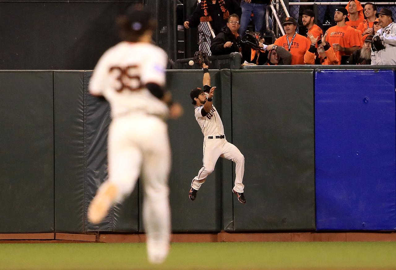 SAN FRANCISCO, CA - OCTOBER 24:  Angel Pagan #16 of the San Francisco Giants catch make a play on Jhonny Peralta #27 of the Detroit Tigers two run home run against Jose Mijares #50 of the San Francisco Giants in the ninth inning during Game One of the Major League Baseball World Series at AT&T Park on October 24, 2012 in San Francisco, California.  (Photo by Doug Pensinger/Getty Images)