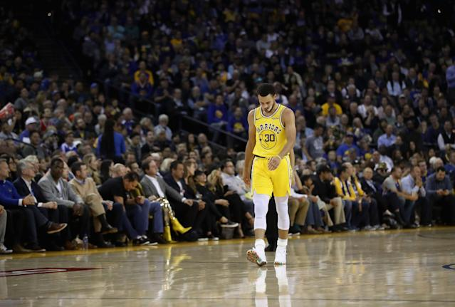 OAKLAND, CA - NOVEMBER 08: Stephen Curry #30 of the Golden State Warriors walks back downcourt during their loss to the Milwaukee Bucks at ORACLE Arena on November 8, 2018 in Oakland, California. (Photo by Ezra Shaw/Getty Images)