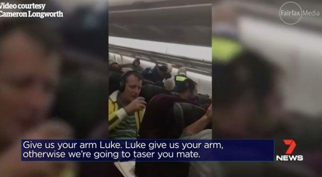 Footage has emerged from the flight, showing police threatening to taser the man. Photo: 7 News
