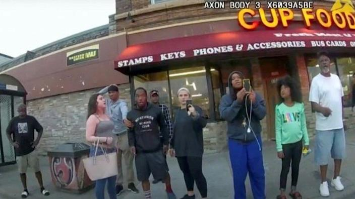 Darnella Frazier pictured with a group of people watching Floyd's arrest
