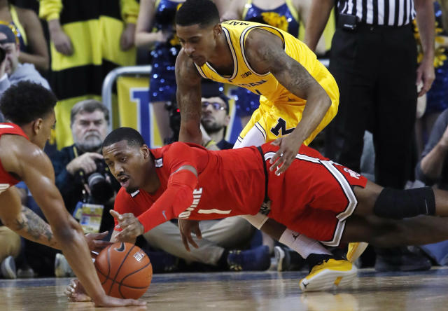 Ohio State guard Luther Muhammad (1) reaches for a loose ball during the first half of the team's NCAA college basketball game against Michigan, Tuesday, Jan. 29, 2019, in Ann Arbor, Mich. (AP Photo/Carlos Osorio)
