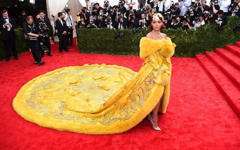 Rihanna wearing Guo Pei couture at the 2015 Met Gala - Credit: AFP