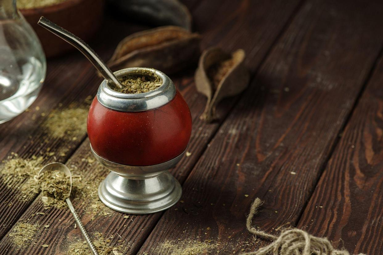 yerba mate in calabash gourd on wooden table