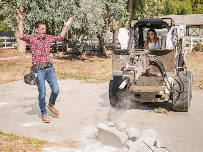Kendall Jenner drives an excavator while a Property Brother looks on.